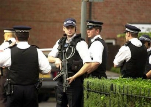 Police guard a cul-de-sac on Scotia Road in Streatham, south London, Saturday July 23, 2005. Residents described Saturday how police raided a house in the street earlier in the afternoon. One neighbour, who only wanted to be named as Marcia, said several police vans had stormed into the area before armed officers rushed to the address and ordered residents to get inside their houses. She said: 'They had already sealed it off and then the officers with guns came along telling us: 'Get inside or you will be arrested.' (AP Photo/PA, Lindsey Parnaby)