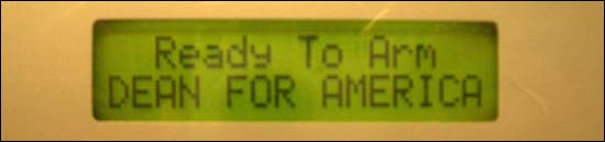 Security alarm screen that reads: Ready to Arm DEAN FOR AMERICA